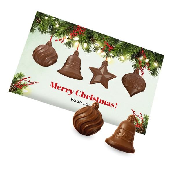 Weihnachtskarte mit Christbaumkugeln aus Schokolade